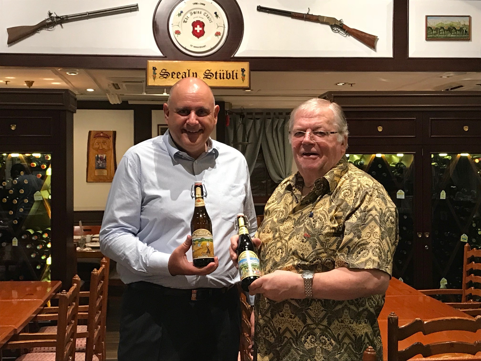 Enjoy a Swiss Quöllfrisch Beer at The Swiss Chalet Restaurant in TST